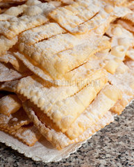 Chiacchiere or frappe italian cake on table