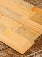Empty wooden cutting board on wood table