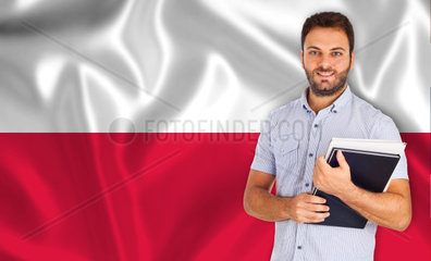 Young male student smiling over Polish flag