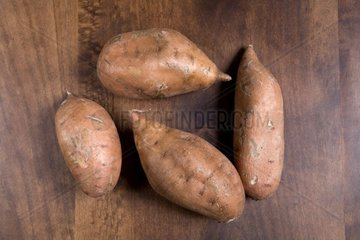 sweet potatoes on wooden table