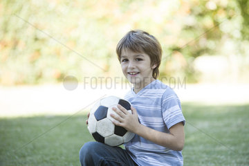 Boy holding soccer ball  portrait