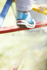 Child climbing on jungle gym  low section