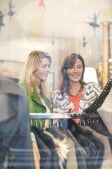 Women shopping in clothing retail store
