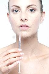 Woman holding up syringe
