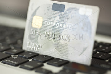 Credit card resting on laptop computer keyboard