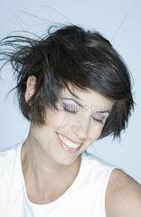 Woman smiling  hair blowing