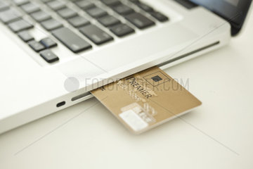 Credit card sticking out of side of laptop computer