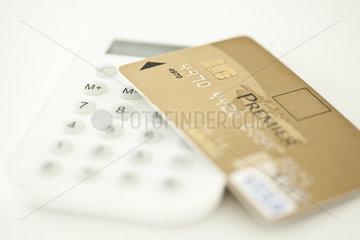 Credit card resting on calculator