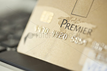 Close-up of credit card resting on computer keyboard
