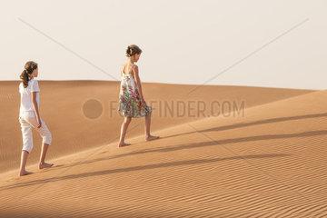 Girls walking in desert