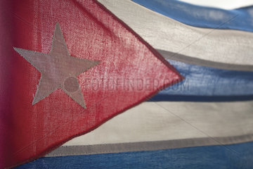 Light shining through Cuban flag  full frame
