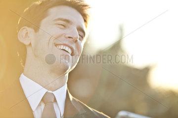 Businessman laughing  portrait