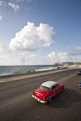 Vintage car driving toward Morrow Castle  Havana  Cuba