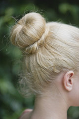 Woman's hair arranged in a chignon
