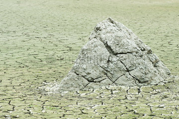 Dry  cracked earth in barren landscape