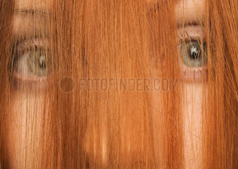Woman with hair in front of face  close-up