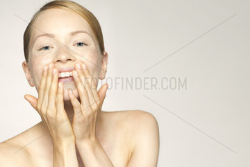 Young woman enjoying soft and smooth results of proper skin care