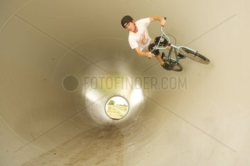 BMX riding in a pipe of a windmill