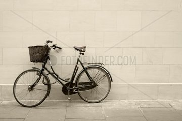 classic bycicle against a brick wall