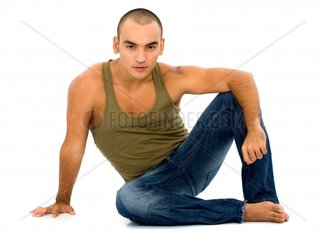 casual man portrait on the floorisolated over a white background