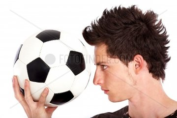 man with a football isolated over a white background