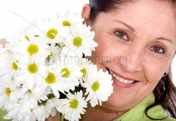 senior woman with flowers on her hands