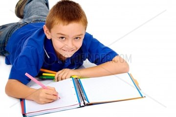 boy studying on the floorisolated over a white background