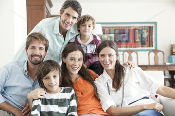 Family together in living room  portrait