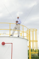 Engineer inspecting chemical storage tank