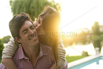 Woman kissing boyfriend on cheek