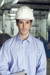 Technician inside industrial plant  portrait