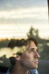 Man looking at view with melancholic air
