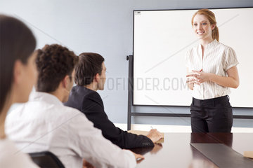 Businesswoman leading business meeting