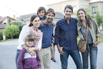Family posing together on suburban street  portrait