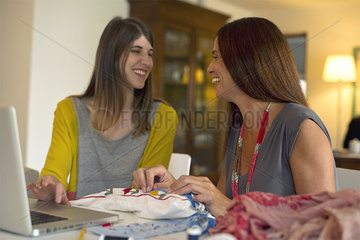 Friends doing embroidery together