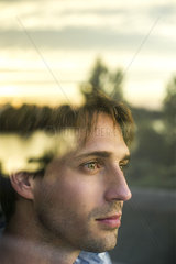 Man looking out window contemplating a future full of potential