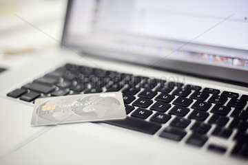 Credit card resting on laptop computer