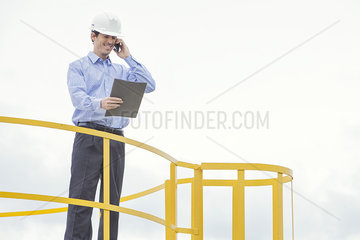 Engineer overseeing oil refinery production