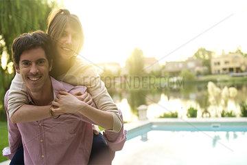 Man giving girlfriend piggyback ride  portrait