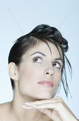 Woman with spiky hairstyle  looking up  portrait