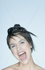 Woman with spiky hairstyle  mouth open  portrait