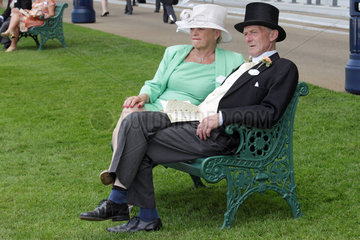 Royal Ascot  Couple in elegant clothes waiting for the races