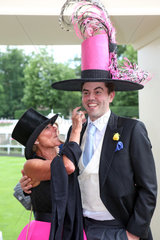 Royal Ascot  Fashion on Ladies Day  couple with witty hats at the racecourse