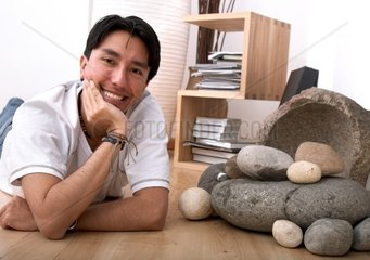 lifestyle image of a young man relaxing at home