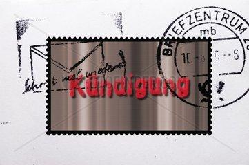 Brief mit Briefmarke und Aufschrift Kuendigung