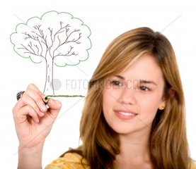 female ecologist drawing a tree on screen over a white background