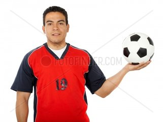 male footballer standing up isolated over a white background