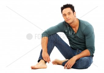 caucasian casual man on the floorisolated over a white background