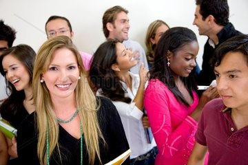 Multiethnic group of university students smiling in a classroom