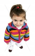 little girl with pigtail wearing colourful hooded cardigan.